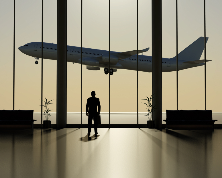 A businessman looking out a departure lounge window at a jet plane. High resolution 3D render.