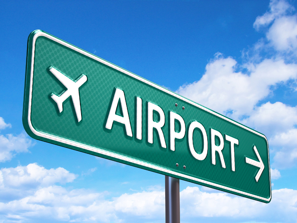 bigstock-Airport-direction-road-sign-48224462
