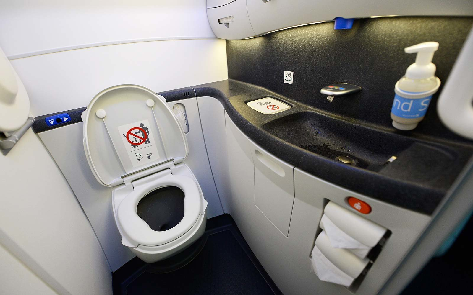 LOS ANGELES, CA - NOVEMBER 30: A touch lavatory is seen on the United Airlines Boeing 787 Dreamliner at Los Angeles International Airport on November 30, 2012 in Los Angeles, California. In January the new jet is scheduled to begin flying daily non-stop between Los Angeles International airport and Japan's Narita International Airport and later to Shanghai staring in March. The new Boeing 787 Dreamliner will accommodate 219 travelers with 36 seat in United Business First, 70 seats in Economy Plus and 113 in Economy Class. The carbon-fiber composite material that makes up more than 50 percent of the 787 makes the plane jet and more fuel-efficient. (Photo by Kevork Djansezian/Getty Images)